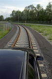 Car on rail 1. Train or car? a real experiment Royalty Free Stock Photo