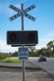 Car on railroad crossing Stock Images