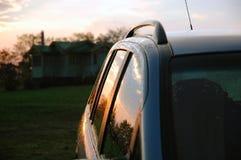 Car after rain. Photo of wet car with sunset light Royalty Free Stock Photos
