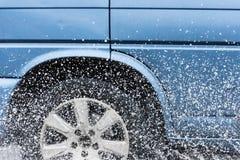 Car rain puddle splashing water Stock Photo