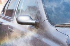 Car rain puddle splashing water Stock Image