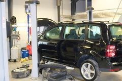 Car raised on car lift in autoservice. royalty free stock photography