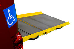 Car ramp for wheelchair user. Close up of International Symbol of Access ISA or wheelchair user blue sticker on the rear of the car and car ramp for disabled royalty free stock photography
