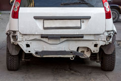 Car without rear bumper. Rear end of dirty car without rear bumper Royalty Free Stock Images