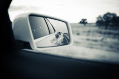 Car rear mirror. Vintage black and white tone. Royalty Free Stock Images