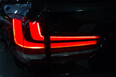 Car rear red lights detail , close-up Stock Image