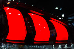 Car rear red lights detail , close-up Stock Photography