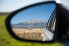 Car rear view of high mountains Stock Image