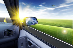 Car and rear view mirror Royalty Free Stock Images