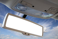 Car rear view mirror. Blank rear view mirror against blue sky Stock Images