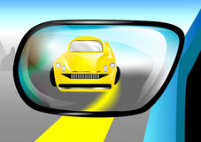 Car in the rear view mirror Stock Images
