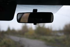 Car rear view mirror isolated on white. Car rear view mirror isolated on white Royalty Free Stock Image