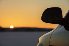 Car rear view mirror photographed in silhouette in Finland. Royalty Free Stock Photos