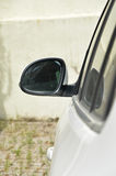 Car and rear view mirror. A white car and rear view mirror Stock Images