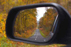 Car rearview. Beautiful autumn trees scene Stock Photography