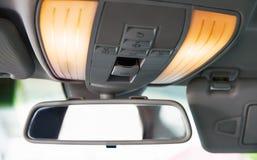 Car rearview mirror. Car interior detail. Close-up Royalty Free Stock Photo