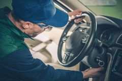 Car Recall Maintenance. Automotive Recall Concept. Technician Preparing Vehicle For the Repair royalty free stock photos