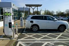 Car recharging. At a recharging point in a motorway recharge station Stock Photos