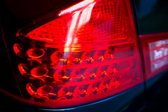 Car red brake light. Close up of car red brake light Stock Image