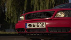 A car of a red color of the brand Audi