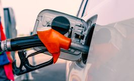 Car refuel in gas station. Selective focus on gas nozzle Stock Image
