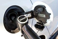 Diesel. Car refueling diesel pump at petrol station royalty free stock image
