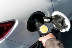 Diesel car. Car refueling diesel pump at petrol station royalty free stock image