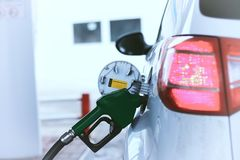 Car refueling gasoline. Outdoor in a winter day Stock Photo