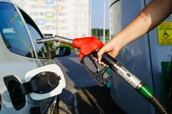 Car refueling on petrol station stock photography
