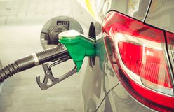 Car refueling at the petrol station. Concept photo for use of fuels gasoline, diesel, ethanol in combustion engines, pollution. Car refueling at the petrol royalty free stock image