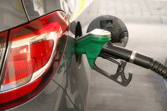 Gasoline car refueling at the petrol station. Concept for use of fossil fuels gasoline, diesel in combustion engines. Car refueling at the petrol station stock image
