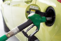 Car refueling on a petrol station stock image