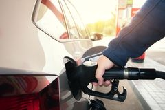 Car refueling on petrol station. Man pumping gasoline oil. This. Photo can be used for automotive industry or transportation concept royalty free stock photos