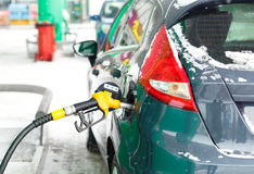 Car refueling on a petrol station in winter. Closeup royalty free stock photos