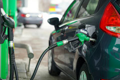 Car refueling on a petrol station in winter. Closeup Stock Photography