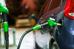 Car refueling on a petrol station in winter at night Royalty Free Stock Photography