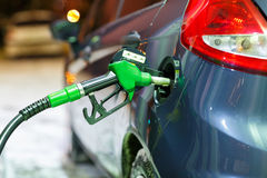 Car refueling on a petrol station in winter at night Stock Image
