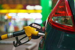 Car refueling on a petrol station in winter at night. Closeup stock photography