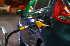 Car refueling on a petrol station in winter at night Royalty Free Stock Photo