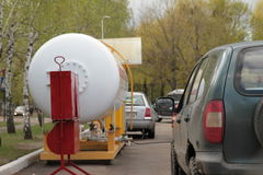Car refueling. Refueling the car with gas. Balloon. Royalty Free Stock Photo
