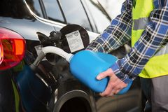 Car refueling on the road Stock Photos