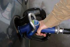 Car refuelling. Man refuelling his car stock photos