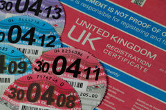 Car Registration Certificate with Car Tax Discs Stock Photo