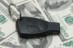 Car remote. Over  the hundred dollar banknotes Stock Image
