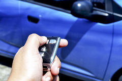 Car Remote Control. A hand holding a car's remote control Stock Photography