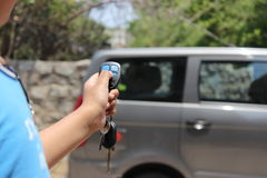 Car Remote Control. A person unlocking the car using a remote controls Royalty Free Stock Photography