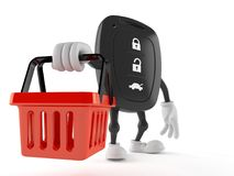 Car remote key character holding empty shopping basket. Isolated on white background Royalty Free Stock Photography