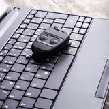 Car remote key and laptop Stock Photos