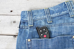 Car remote starter in blue jeans back pocket Royalty Free Stock Photo