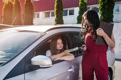 Car rent ` deal between dealer. `Car rent ` deal between dealer and customer royalty free stock photography